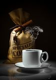 Composition of white cup and sack of coffee beans Royalty Free Stock Photography