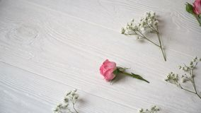 Composition of white and pink flowers rustic style, for St. Valentine`s Day with a place for your text. Flat lay, top. View stock video