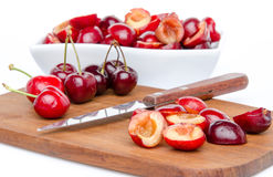 Composition with whole and pitted cherries Royalty Free Stock Image