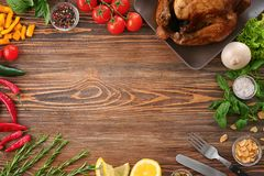 Composition with whole roasted turkey. And some products on wooden background Stock Photos