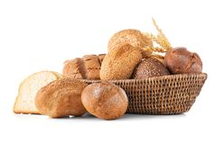 Composition with wicker basket and different bread. Isolated on white Stock Photos