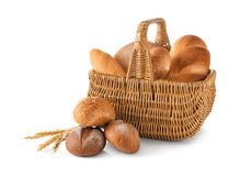 Composition with wicker basket and different bread. Isolated on white Royalty Free Stock Photography