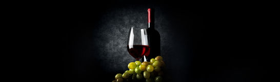 Composition with wine on black Royalty Free Stock Images