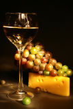 Composition with a wine glass, cheese and grapes Stock Photography