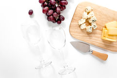 Composition with wineglasses, cheese and grape on white background top view Stock Photo