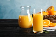 Free Composition With Orange Juice And Fresh Fruit On Table Stock Photo - 141417990
