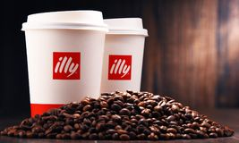 Free Composition With Paper Cups Of Illy Coffee And Beans Royalty Free Stock Photo - 110141035