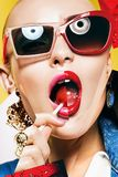 Composition of women in sunglasses with lollipop stock photo