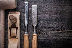 Composition of wooden hammer metal chisels planer Stock Images