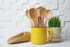 Composition with wooden spoons in mug Royalty Free Stock Image