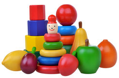 Composition with wooden toys, pyramids, fruits and cubes Royalty Free Stock Photo