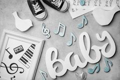 Composition with word BABY and notes. On light background royalty free stock photo