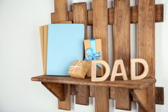 Composition with word DAD for Father`s Day. Composition with word DAD for Father's Day on wooden shelf Stock Photography