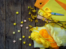 Composition of yellow accessories for hobby on grey wooden background. Knitting, needlework, sewing, painting, origami. Small busi Royalty Free Stock Images