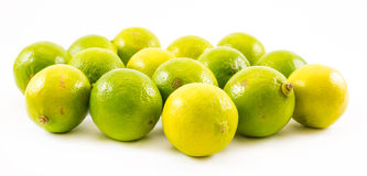 Composition of a yellow and green lemons and lime on a white background Royalty Free Stock Photo