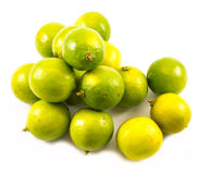 Composition of a yellow and green lemons and lime on a white background - top view Stock Photo