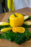Composition of yellow pepper, slices of orange, apples and spinach Royalty Free Stock Images