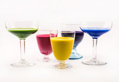 Composition of yellow, pink, violet, blue and green colored cocktails on a white background Stock Photo