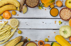 Composition of yellow vegetables, beans and fruits - banana, corn, lemon, plum, apricot, pepper, zucchini, tomato, asparagus bean, Stock Photography