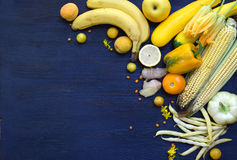 Composition of yellow vegetables and fruits - banana, corn, lemon, plum, apricot, pepper, zucchini, tomato, asparagus beans, ginge Stock Photo