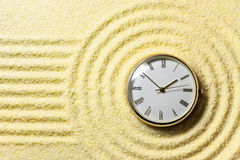 Composition on Zen garden - sand, and watch Royalty Free Stock Images