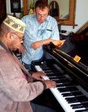 Compositores que trabajan junto Foto de archivo libre de regalías