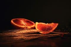 Composizione arancione nel granulo Immagine Stock