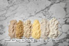 Composizione con differenti tipi di farine Immagini Stock