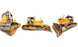 Composizione con i bulldozer sporchi pesanti della costruzione di colore giallo Immagini Stock Libere da Diritti