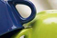 Composizione con le tazze colorate Fotografia Stock