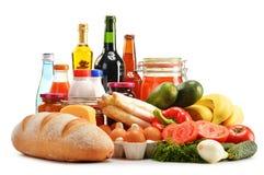Composizione con varietà di prodotti della drogheria su bianco Immagini Stock Libere da Diritti