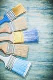 Composizione dei pennelli sul concetto della costruzione del bordo di legno Fotografia Stock Libera da Diritti
