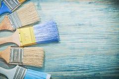 Composizione dei pennelli sul concetto di legno della costruzione del bordo Fotografia Stock