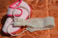 Composizione nel legame della perla e del caricamento del sistema Immagini Stock