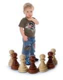 Composizione in scacchi con il ragazzo fotografie stock