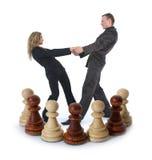Composizione in scacchi con la ragazza e l'uomo Immagini Stock Libere da Diritti