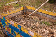 Compost bin. Wooden box fully loaded with compost Stock Image