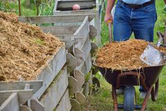 Compost bin and barrow of manure Royalty Free Stock Photo