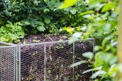 Compost bin in garden Stock Photos
