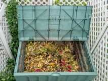 Compost bin. Green plastic compost bin full of organic and domestic food scraps Royalty Free Stock Images