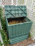 Compost bin. Green plastic compost bin full of organic and domestic food scraps Stock Photo