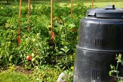 Compost bin and vegetable garden stock photos