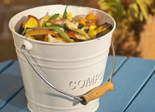 Compost Bucket. Detail outdoor shot of a kitchen compost bucket stock photos