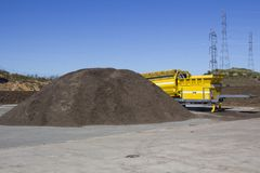 Compost. Pile of mulch at a green recycle plant ready to be fed into an industrial grinder to make compost Stock Photos