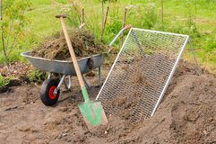 Compost pile sieve. Compost pile, spade and sieve in garden Royalty Free Stock Image