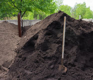 Compost ready to enrich gardens and plantings. Environmentally friendly,fertile compost made from organic and food waste ready for the plants and gardens in Royalty Free Stock Photo