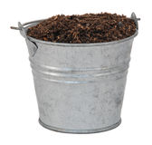 Compost / soil / dirt in a miniature metal bucket Stock Photography