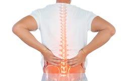 Composto de Digitas da espinha Highlighted do homem com dor nas costas fotos de stock royalty free