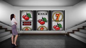 Composto de Digitas de uma mulher de neg?cios e de um slot machine do casino video estoque