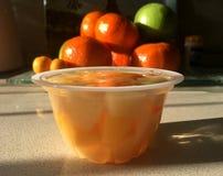 Compota de fruta en fondo de la fruta Imagen de archivo libre de regalías